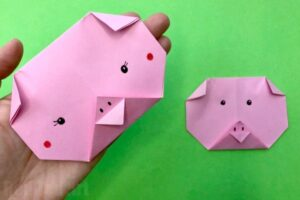 How to make an Origami Pig Face for Preschoolers. This is an easy Paper Pig Craft for kids to make - either as part of Farm Animal Studies or for Year of the Pig Activities #origami #pig #yearofthepig #preschool #farmanimals #paperpig