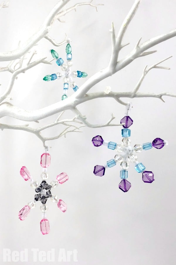 DIY Pipe Cleaner Snowflake Ornaments - how to make snowflakes with beads and pipe cleaners. Gorgeous Snowflake Decorations for Christmas and Winter suitable for preschool, middle school and grown ups! #snowflakes #pipecleaners #beads
