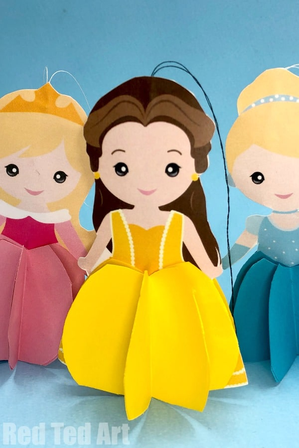 Easy Paper Belle Ornament. Part of our 7 Princess Ornament series. These free printables make great Christmas Decorations or 3d Paper Dolls to play with #christmas #princess #ornaments #printables