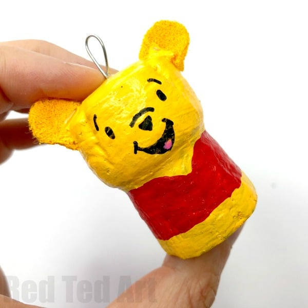 DIY Winnie The Pooh Ornament Craft. How to make a Cork Pooh Bear Ornament for Christmas. Cork Christmas Ornament Keepsakes #Poohbear #WInniethepooh #corks #ornaments #keepsakes