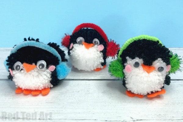 How to make a penguin pom pom ornament - super cute and easy pom pom penguins for kids to make. Christmas crafts for kids. #Christmas #Winter #pompoms #penguins