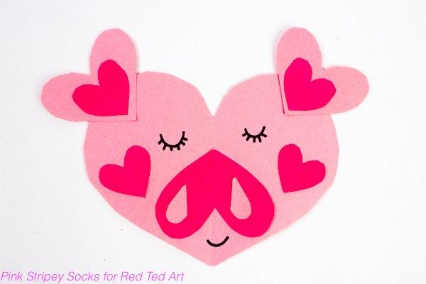 Have a go at this easy Paper Heart Pig Craft for Kids. These make the cutest of cute Valenitnes Cards or Valentines Craft Idea for Preschoolers. We love Paper Valentine's Crafts. Great Craft for The Year of the Pig too! #valentines #papercrafts #hearts #heartanimals #pigs #yearofthepig #preschool