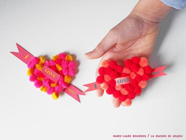 A cute Valentine's Gift for Kids to make - easy Heart Pom Pom Pin! An easy Kids' Valentine's Day Craft to keep or give to a loved one. #valentines #pompoms #hearts #gifts