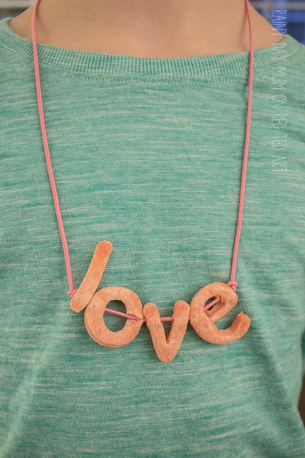 Try out these fun lt Dough LOVE Necklace for Valentine's Day. Salt Dough Crafts for Valentine's. BFF Love Crafts for Kids to make on Valentine's Day. Salt Dough Crafts. #Valentines #saltdough #bff #kids