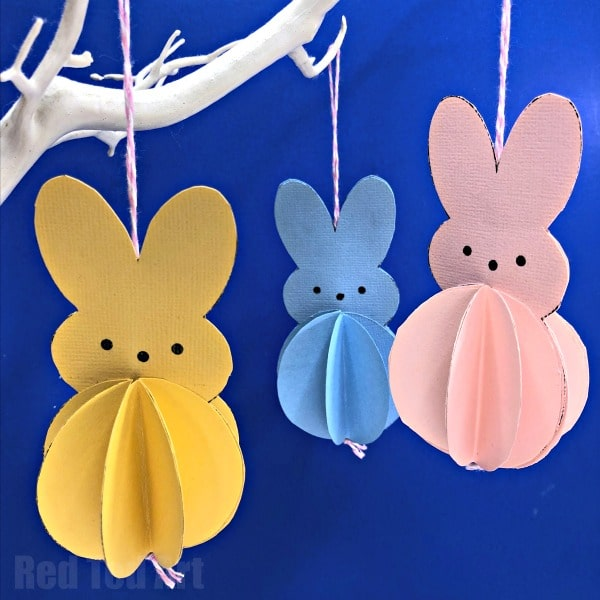 Learn how to make an easy paper Peeps Bunny Decoration for the Easter Tree. An easy paper rabbit craft using construction paper or other paper. These Peeps inspired decorations come complete with Paper Bunny Template, Worksheet and Printable Lesson plan. Adorable Paper Bunnies for Kids to make for the Easter Tree #Easter #paper #decorations #ornaments #bunny #rabbit #eastertree