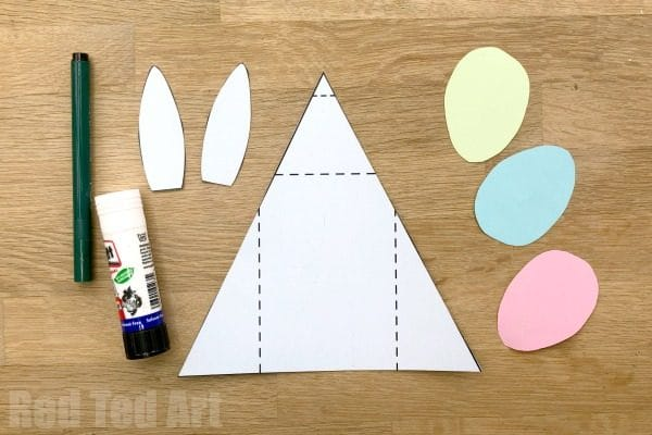 Exploring Triangles in the classroom? A fun Trinagle Paper Craft Bunny for Easter. Turns into an easy folding Easter Card too. Simple 3d Paper Bunny! #easter #paper #steam #shapes #maths #cards #bunny #lessonplans