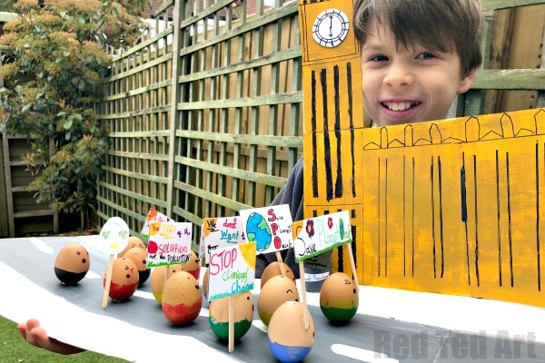 Boy holidng the Egg Decorating competition Project (Climate Change March march & Big Ben)