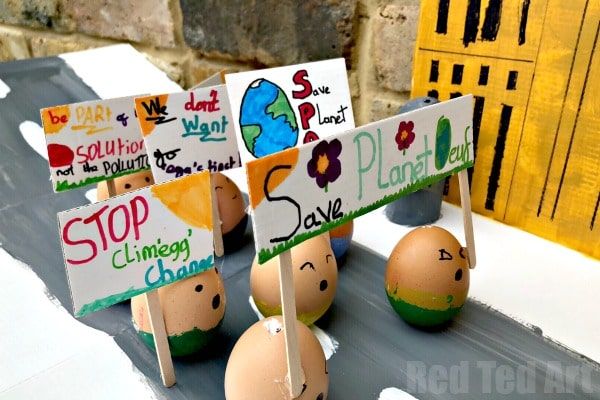 Detail from the Climate Change March model - showing the climate change plackards