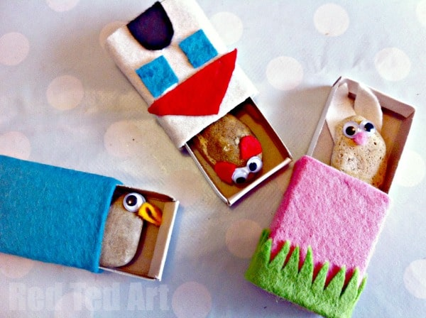 Collection of three stone pets in their matchbox homes - bunny, duck and mouse