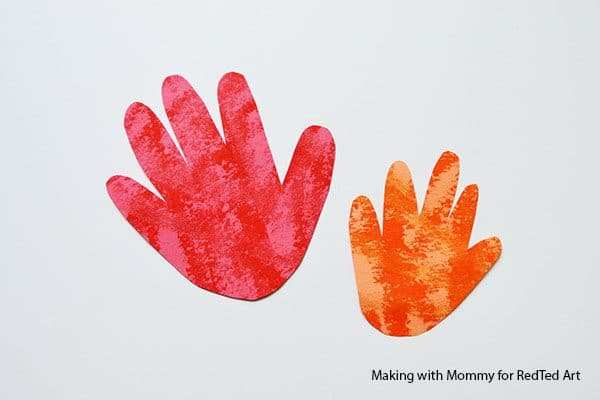 handprints from dad and child for fire rocket
