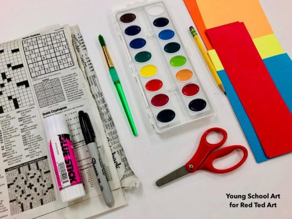 Newspaper and art supplies for art project