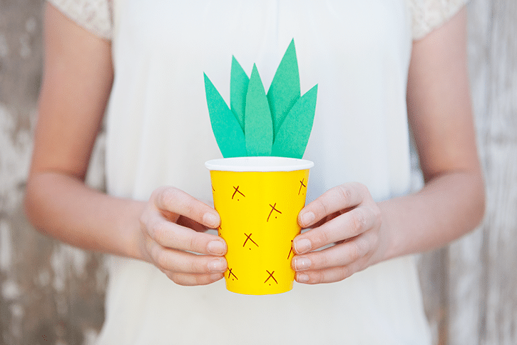 child holding paper cup pineapple