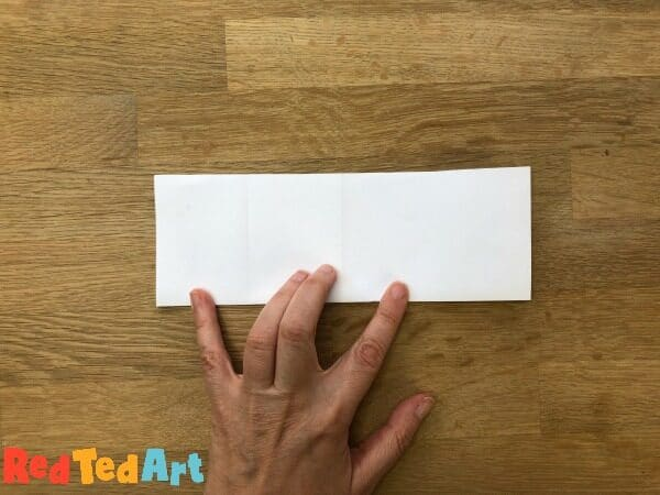 Fold the paper width wise