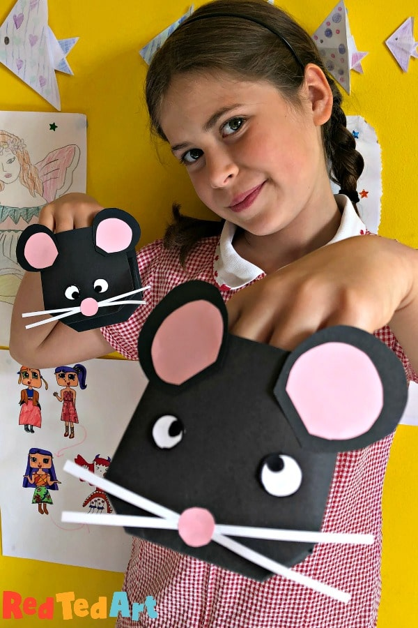 child with rat puppet made from paper