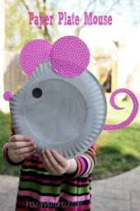 Preschooler holding Paper Plate Mouse made easy