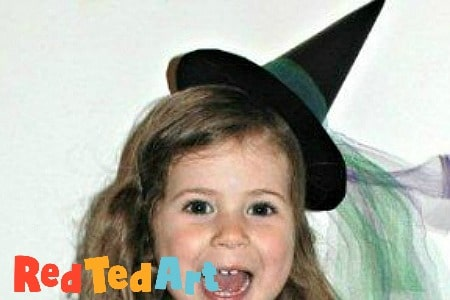 Girl wearing paper witch hat fascinator
