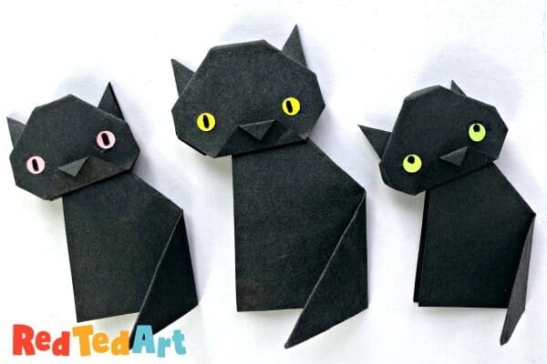 3 little black cats made from origami paper