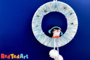 Penguin Pom Pom Wreath made with Paper Plates