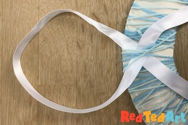 Attaching a ribbon to your yarn wreath