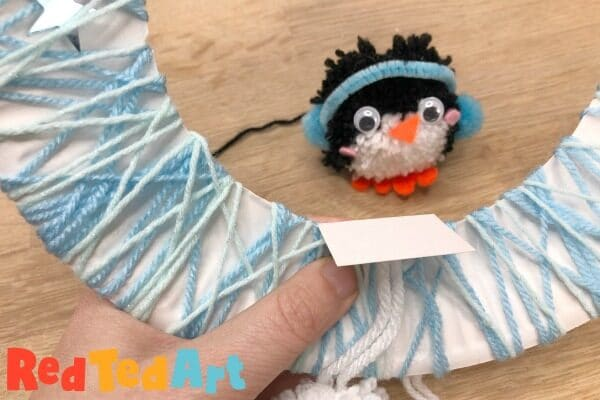 Pompom Wreath for Christmas with Penguin
