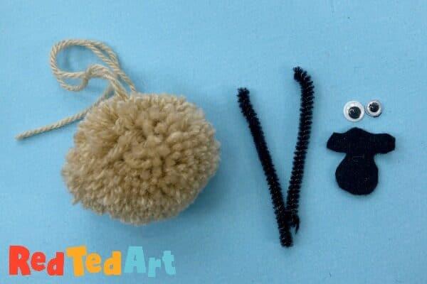Turning a pom pom into a sheep