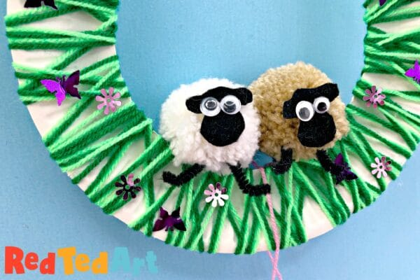 Adorable pom pom sheep on a wreath