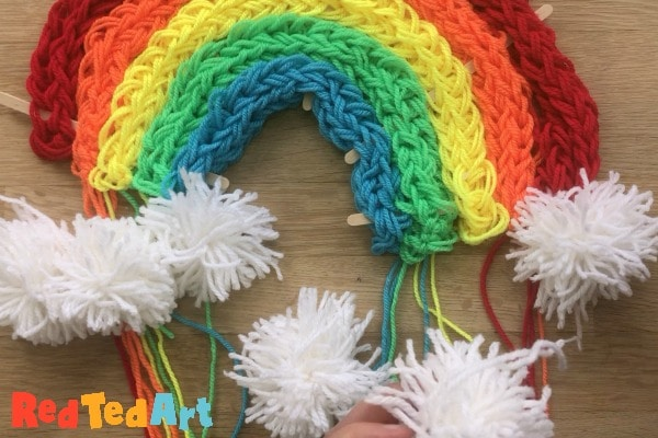secure the pompoms to the rainbow