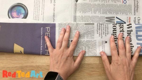 Fold the newspaper